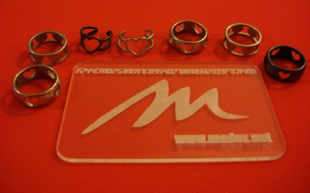 The various rings from Shapeways next to a Ponoko test card :)