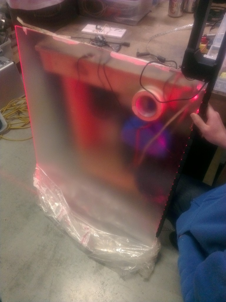 Quirky use of the BBB at the hackerspace to side illuminate an acrylic panel